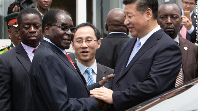 China's President Xi Jinping shakes  hands  with Zimbabwe's President Robert Mugabe in Harare