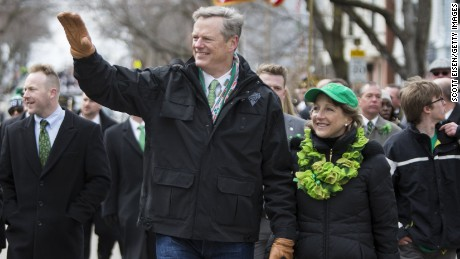 Governor Charlie Baker of Massachusetts and wife Lauren Baker march in the annual South Boston St. Patrick's Parade on March 20, 2016.