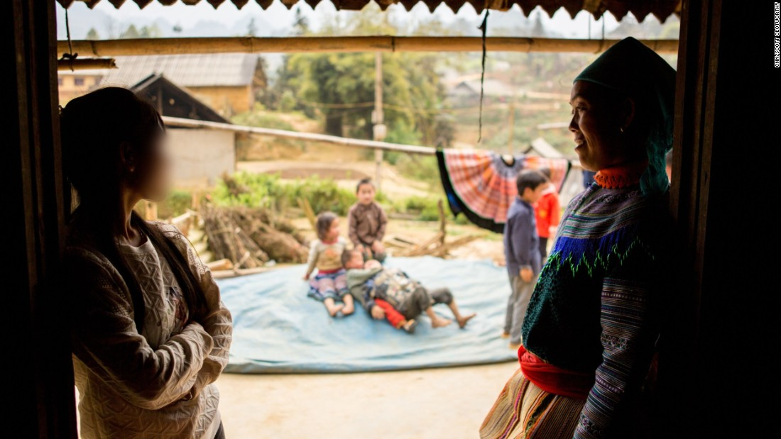 A young woman, left, visits her mother in Northern Vietnam. She was tricked by traffickers into crossing the border to China, but managed to escape before they could force her into a marriage. She is now back in her home country sharing her story to warn vulnerable girls about trafficking.