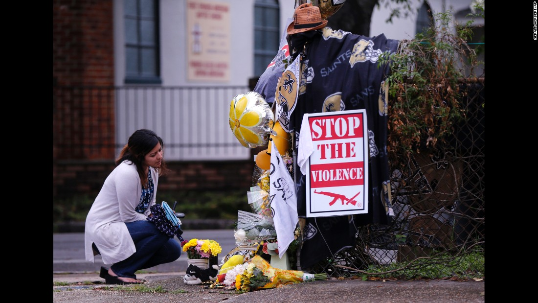 "A woman pauses at a makeshift memorial near the spot where former pro football player Will Smith <a href=""http://www.cnn.com/2016/04/14/us/will-smith-former-new-orleans-saints-player-killed/"" target=""_blank"">was fatally shot</a> in New Orleans on Saturday, April 9. He was 34."