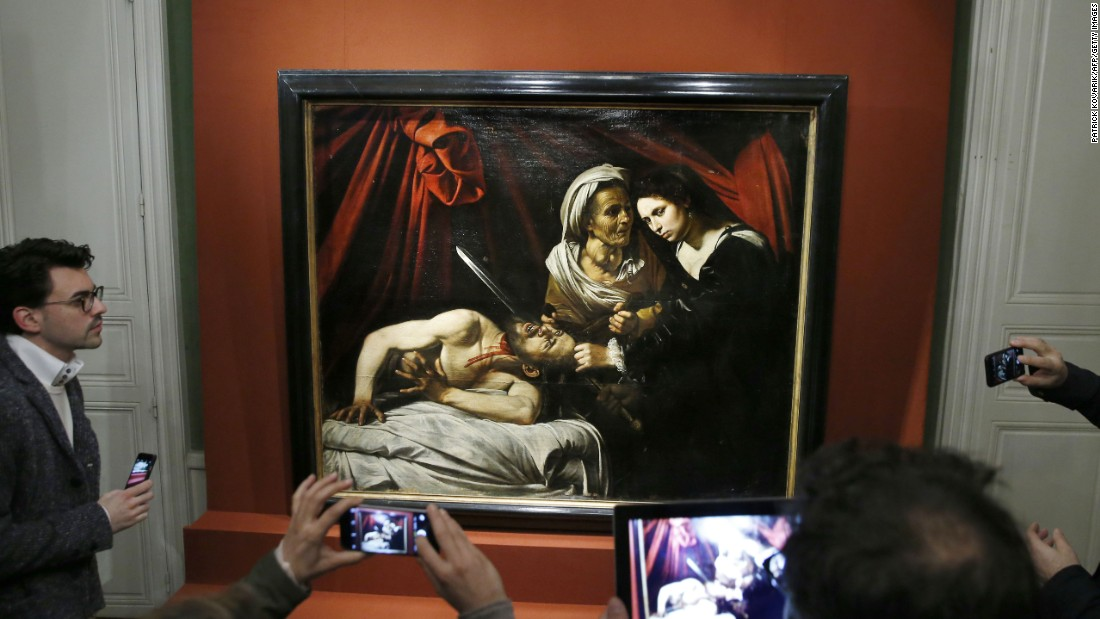"People in Paris take photos of ""Judith Beheading Holofernes,"" a 400-year-old painting, on Tuesday, April 12. The painting, which is thought to be the work of Italian master Caravaggio, <a href=""http://www.cnn.com/2016/04/13/europe/treasured-french-painting-recovered/index.html"" target=""_blank"">was found by accident</a> in a house attic. Experts value it at around 120 million euros ($136 million)."