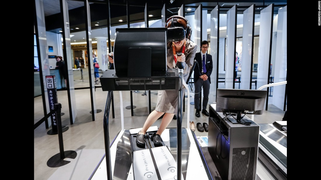 A woman tests a virtual-reality game at a Tokyo shopping mall on Monday, April 11.