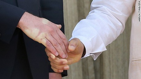 A strong handshake by Indian prime minister Nanrendra Modi leaves an impression on Prince William's hand on April 12.