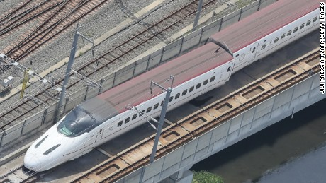 A derailed Kyushu shinkansen, or bullet train, in the city of Kumamoto.