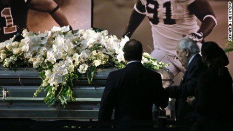 New Orleans Saints owner Tom Benson and his wife Gayle Benson view the casket of former Saints defensive end Will Smith during a public viewing inside the team's NFL football training facility in Metairie, Louisiana, Friday, April 15.