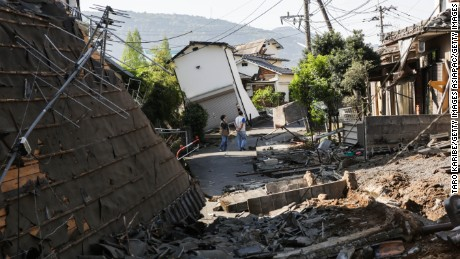 KUMAMOTO, JAPAN - APRIL 16: Houses are seen destroyed after a recent earthquake on April 16, 2016 in Kumamoto, Japan. Following a 6.4 magnitude earthquake on April 14th, the Kumamoto prefecture was once again struck by a 7.3 magnitude earthquake, killing 9 people. (Photo by Taro Karibe/Getty Images)