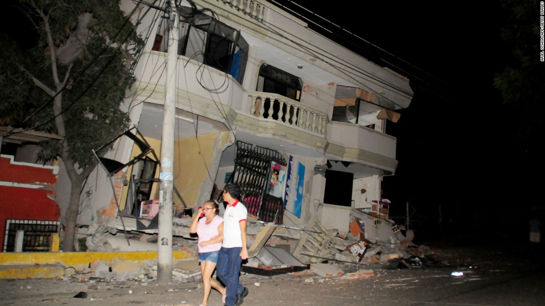 Residents walk on a street amid destroyed buildings in Guayaquil on April 16.