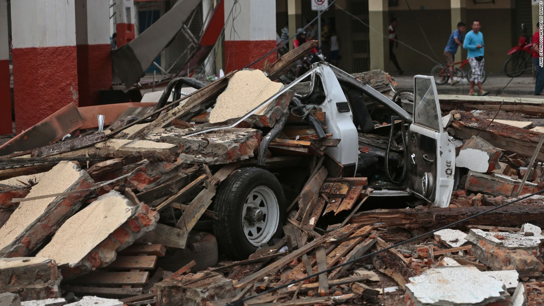 A destroyed vehicle lies under debris in Portoviejo on April 17.