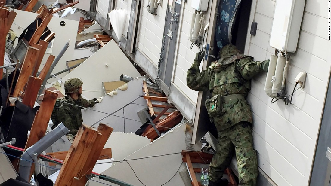 Soldiers search for survivors at a collapsed apartment in Minamiaso on April 17.