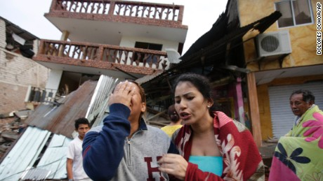 A woman cries as she stands next to house destroyed by the earthquake in the Pacific coastal town of Pedernales, Ecuador, Sunday, April 17, 2016. The strongest earthquake to hit Ecuador in decades flattened buildings and buckled highways along its Pacific coast, sending the Andean nation into a state of emergency. As rescue workers rushed in, officials said Sunday at least 77 people were killed, over 570 injured and the damage stretched for hundreds of miles to the capital and other major cities.(AP Photo/Dolores Ochoa)