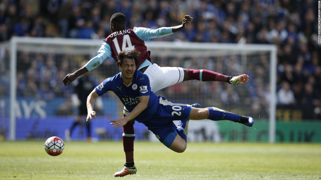 West Ham United's Spanish midfielder Pedro Obiang (back) and Leicester City's Japanese striker Shinji Okazaki (front) battle for the ball during the English Premier League football match between Leicester City and West Ham United at King Power Stadium in Leicester.