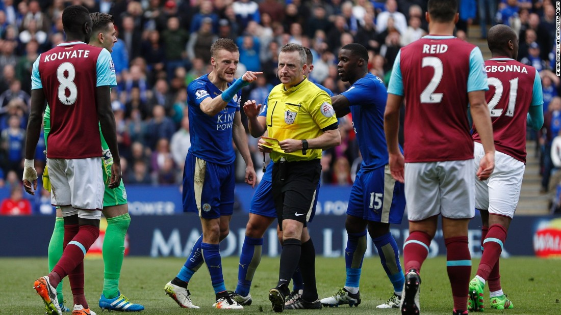 Leicester City's striker Jamie Vardy (3L) reacts after referee Jonathan Moss (C) showed Vardy his second yellow card for simulation to send him off during the English Premier League football match between Leicester City and West Ham United. Vardy will miss Leicester's next match.