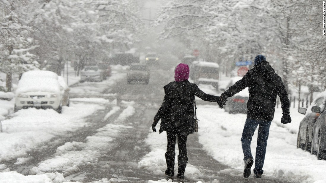 Maddie and Conal McArdle walk down a snow-covered street in Boulder, Colorado, on Sunday, April 17. A snowstorm that brought heavy snow to parts of the state and Wyoming and rain to Oklahoma and Texas is dumping more snow in the Rocky Mountains.