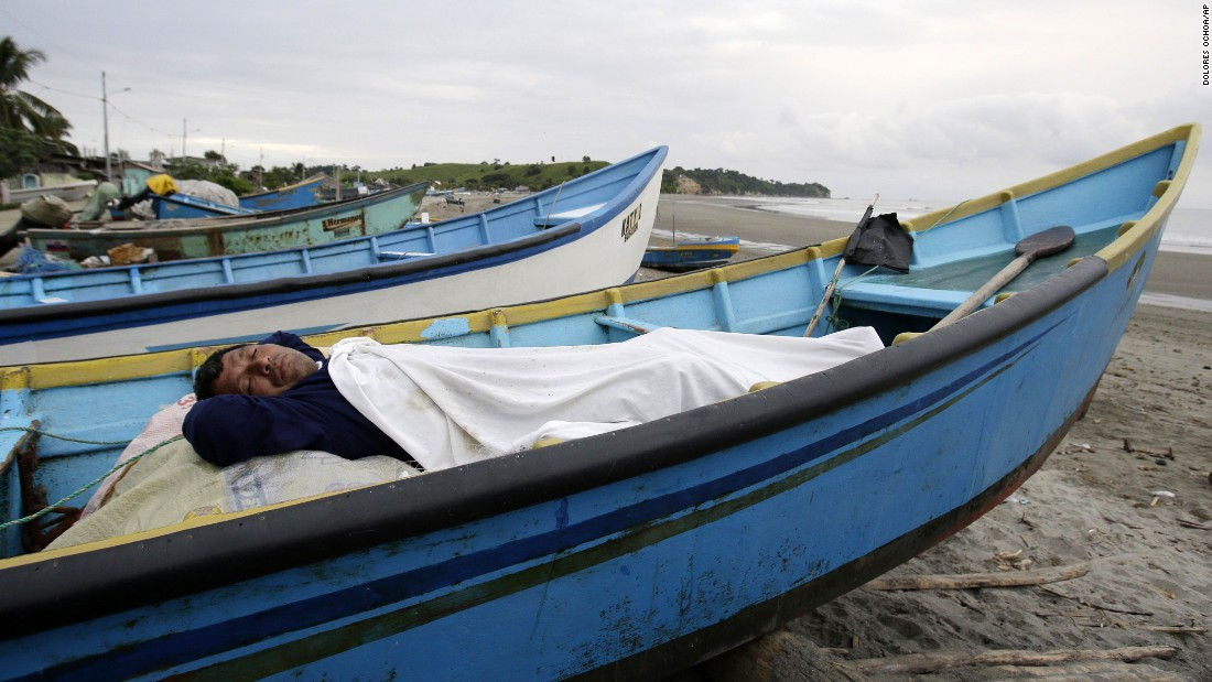A man, his home destroyed by the earthquake, sleeps in a boat docked along the shore in La Chorrera on April 18.
