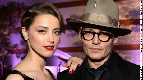 LOS ANGELES, CA - JANUARY 11:  Actors Amber Heard (L) and Johnny Depp attend The Art of Elysium's 7th Annual HEAVEN Gala presented by Mercedes-Benz at Skirball Cultural Center on January 11, 2014 in Los Angeles, California.  (Photo by Michael Kovac/Getty Images for Art of Elysium)