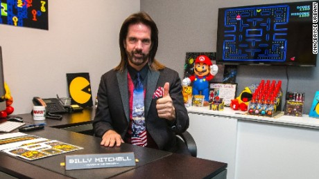 Billy Mitchell sits in his Hollywood, Florida, office where he develops custom arcade game covers.