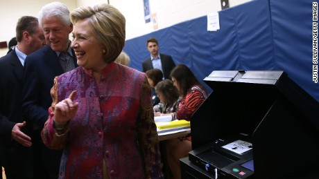 Democratic presidential candidate former Secretary of State Hillary Clinton and her husband former U.S. president Bill Clinton casts her ballot at Douglas Grafflin Elementary School on April 19, 2016 in Chappaqua, New York.