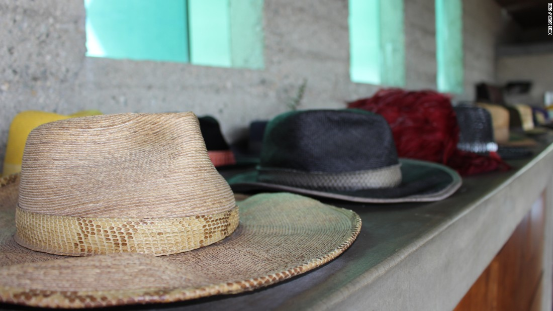 Never spotted without a hat, Goldstein displays a custom-designed collection by the walls of his bedroom. Glass windows above the hats peer into the architectural marvel's swimming pool.