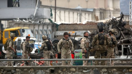 Afghan security forces inspect the site of a Taliban-claimed deadly suicide attack in Kabul, Afghanistan, Tuesday, April 19, 2016. Armed militants in Afghanistan have staged a coordinated assault on a key government security agency in the capital Tuesday morning, killing many and wounding more than 320 people. (AP Photo/Massoud Hossaini)
