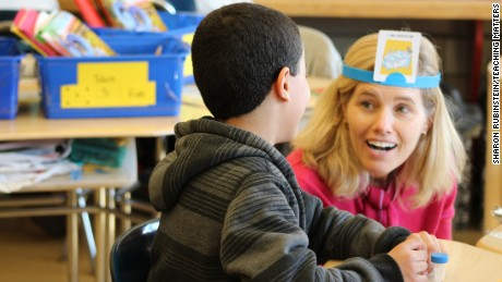 CNN's Kelly Wallace takes part in a game of Hedbanz during reading instruction at P.S. 94 in the Bronx.