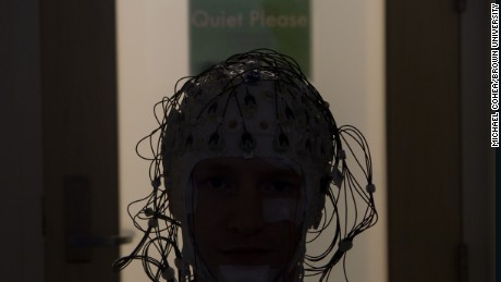 Electrodes monitor a person's brain activity as they sleep.