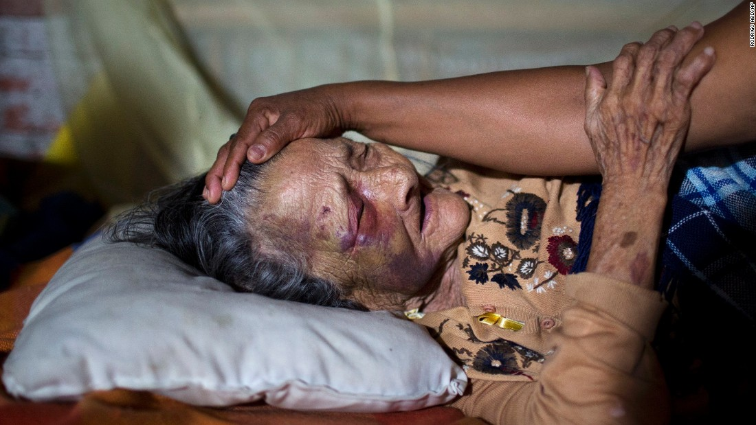 Maria Victoria, 89, is comforted by her daughter Mariana in Estancia Las Palmas on April 19. The elderly woman was injured when a column fell on her.