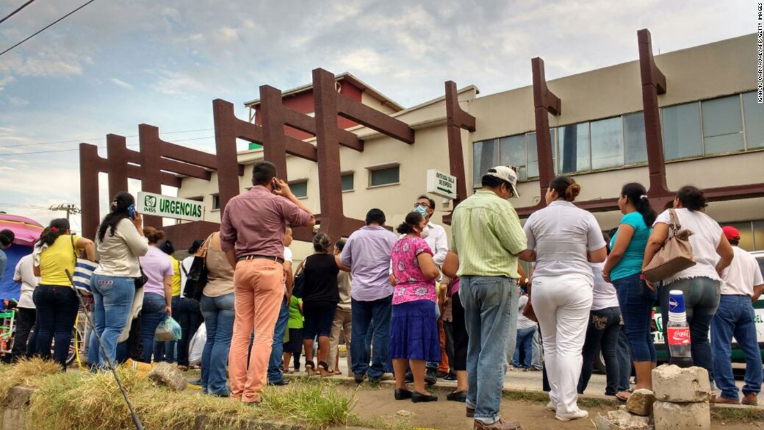 Relatives wait outside a hospital after the explosion.