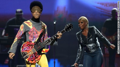 Prince and singer Mary J. Blige perform onstage in 2012 at the iHeartRadio Music Festival in Las Vegas, Nevada