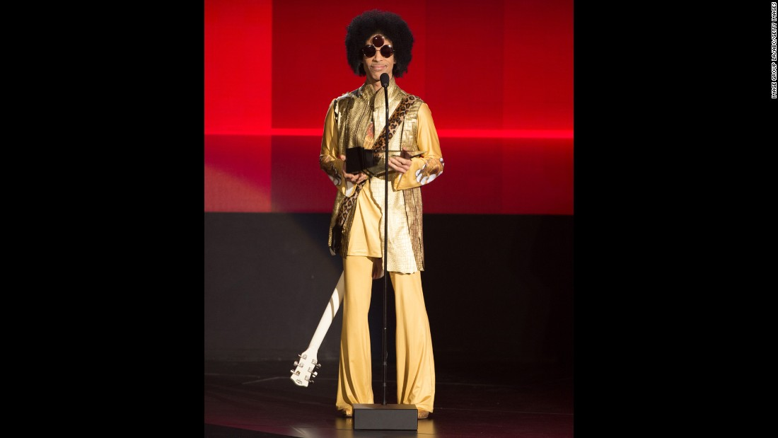 Solid gold -- Prince speaking onstage during the 2015 American Music Awards.<br />