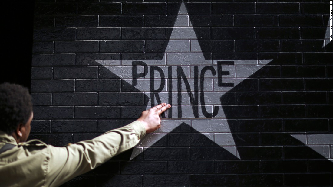After kissing his fingers, a fan touches Prince's star on the wall of First Avenue and 7th St. Entry in Minneapolis, Minnesota, on April 21. The legendary musician died at his home in Minnesota at the age of 57.