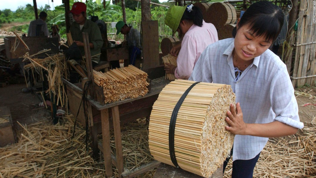 Bamboo chopsticks being made in a factory in Vietnam where thousands of chopsticks are made daily and exported to Japan.