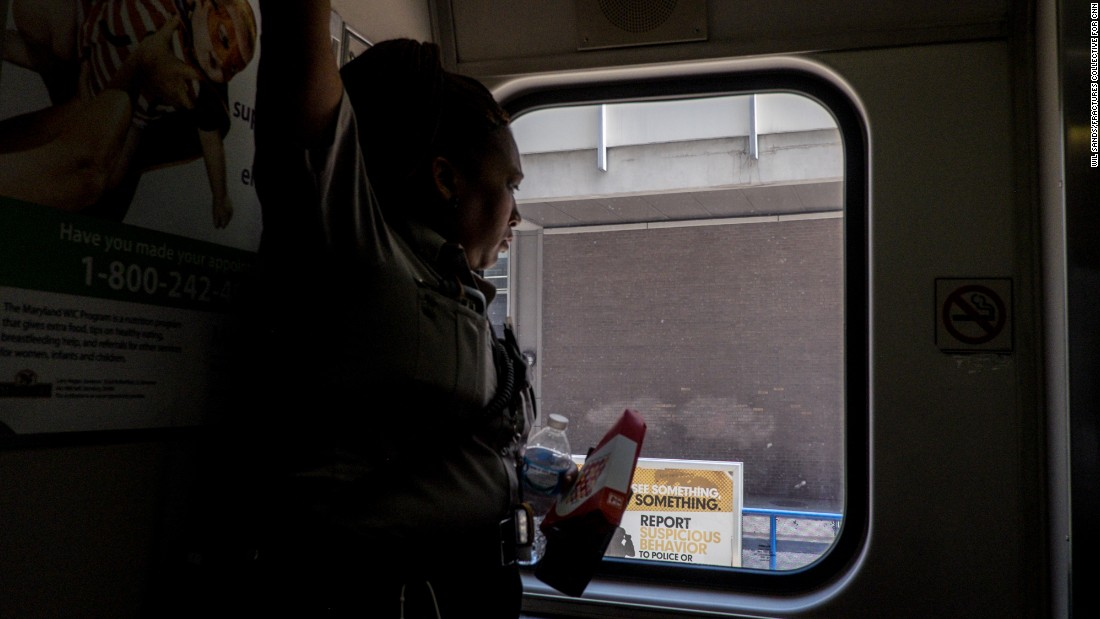 A security guard looks out the window of a Tram rail car in downtown Baltimore. An ambitious rail project that would have connected the black community in West Baltimore to other areas of the city was recently killed by the governor.<br /> <br />