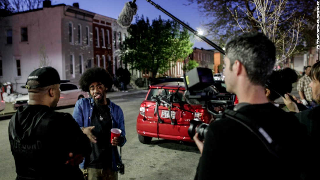 Photographer Devin Allen talks with a friend on camera for an upcoming HBO documentary on Baltimore. Allen was thrust into the national stage after his coverage of the riots on Instagram landed his work on the cover of TIME magazine. <br />