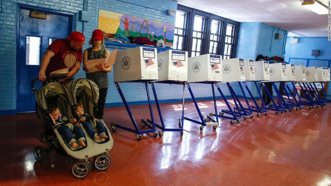 "A couple check their documents before they cast their votes at a polling station in Brooklyn, New York, during the <a href=""http://www.cnn.com/2016/04/19/politics/new-york-primary-voter-problem-polls-sanders-de-blasio/index.html"" target=""_blank"">New York presidential primary</a> on Tuesday, April 19."