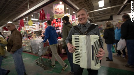 Tony Krupski, 73, plays the accordion at the Broadway Market in East Buffalo.