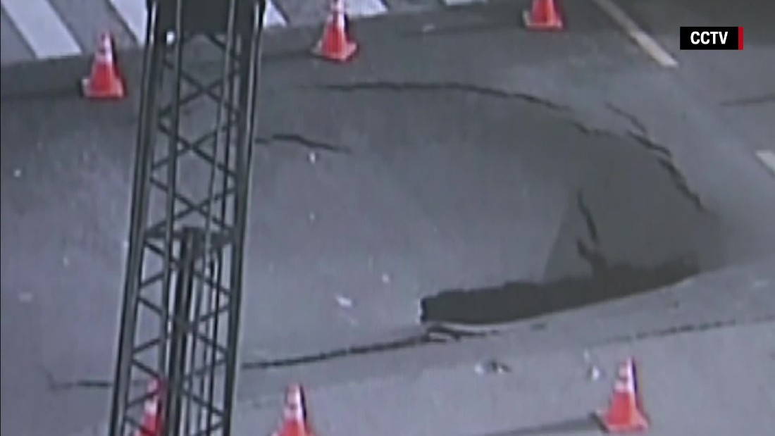 Giant sinkhole swallows busy intersection