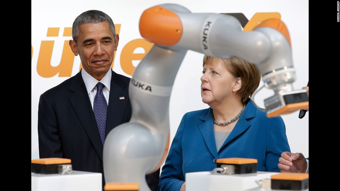 Obama and Merkel look at a robotic device April 25 as they tour the Hannover Messe, the world's largest trade fair for industrial technology.