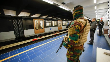 A Belgian serviceman stands guard as a train arrives at the Maelbeek - Maalbeek metro station on its re-opening day on April 25, 2016 in Brussels, after being closed since the 22 March attacks in the Belgian capital. Maelbeek - Maalbeek metro station was hit by one of the three Islamic State suicide bombers who struck Brussels airport and metro on March 22, killing 32 people and injuring hundreds. / AFP PHOTO / BELGA / THIERRY ROGETHIERRY ROGE/AFP/Getty Images
