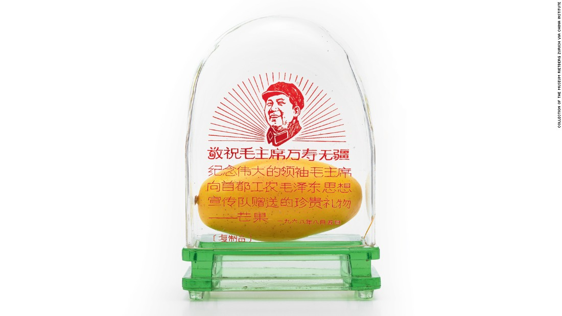 The political message of the gift was clear: workers, not students, would be in charge of the Cultural Revolution. The symbol was quickly adopted and mangoes were bused into provincial towns and exhibited in public. Display cases, like this one, were given to workers as merit awards.