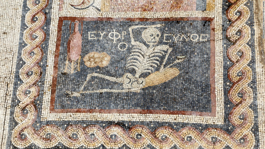 Laid-back ancient skeleton mosaic has sage advice