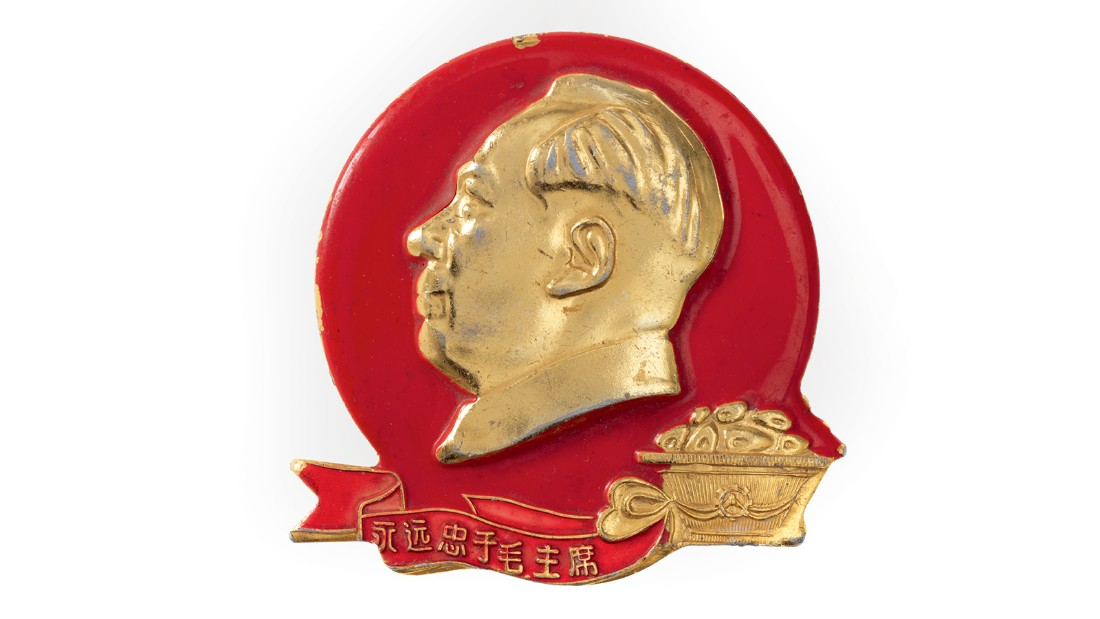 Badges, like this one showing Mao's profile with a basket of mangoes, were an inexpensive way to show allegiance.