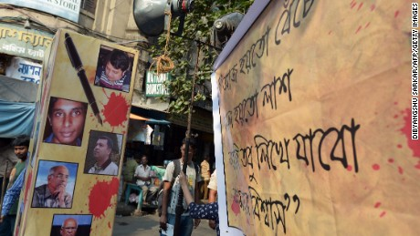 A protest poster with pictures of recently murdered Bangladeshi bloggers.