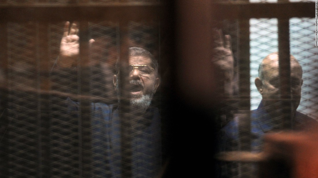 Morsy, left, and Muslim Brotherhood leader Mohamed Badie stand behind bars in June 2015. Morsy was sentenced to death for his role in a 2011 prison break. He and 16 other Muslim Brotherhood leaders were also given a life sentence for espionage. A life term in Egypt means 25 years.