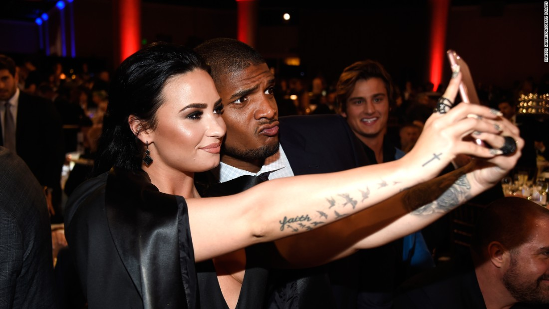 Singer Demi Lovato and football player Michael Sam take a selfie at the GLAAD Media Awards on Saturday, April 2.
