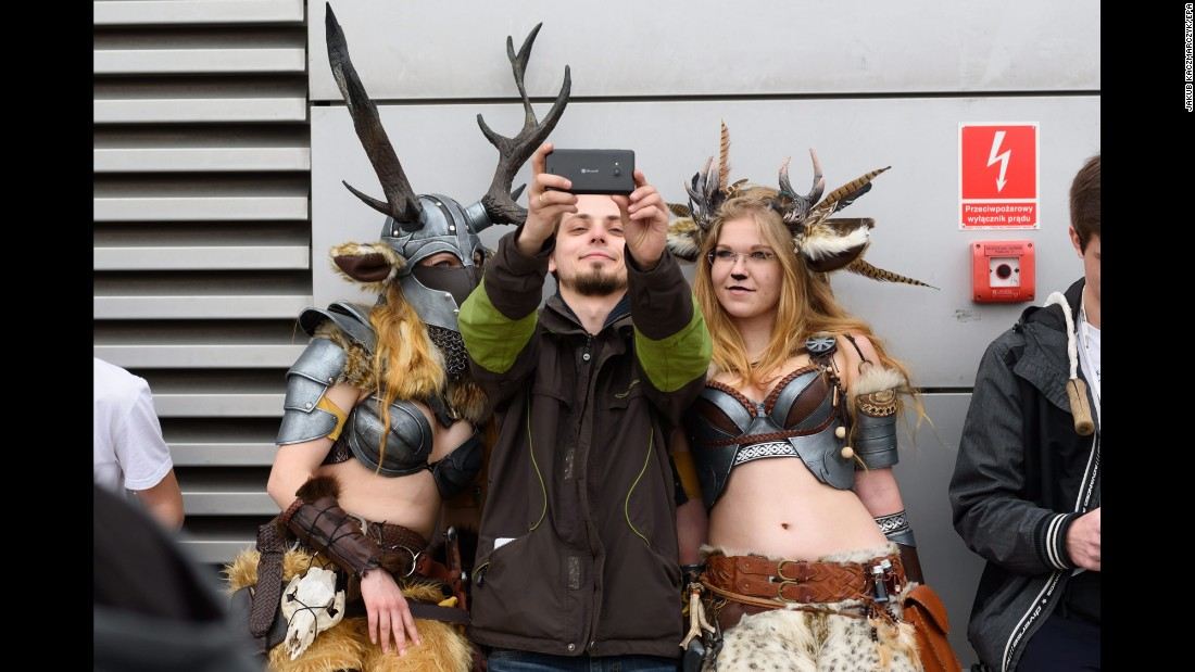 People in costume take a selfie at the Pyrkon Festival, a fantasy convention in Poznan, Poland, on Saturday, April 9.