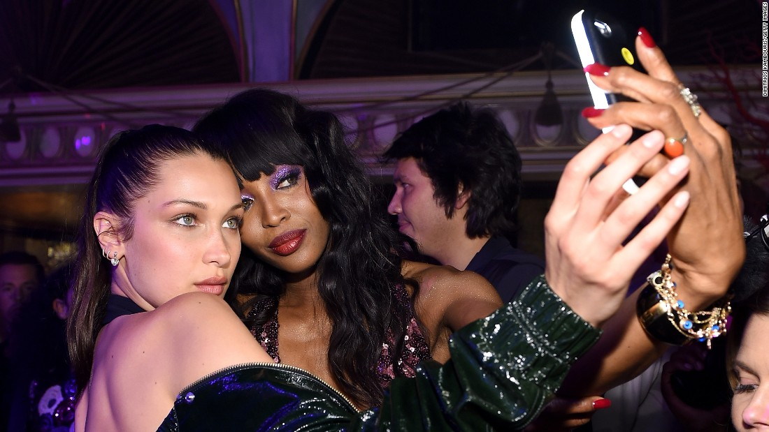 Models Bella Hadid, left, and Naomi Campbell take a photo together during a book launch party in New York on Thursday, April 7.