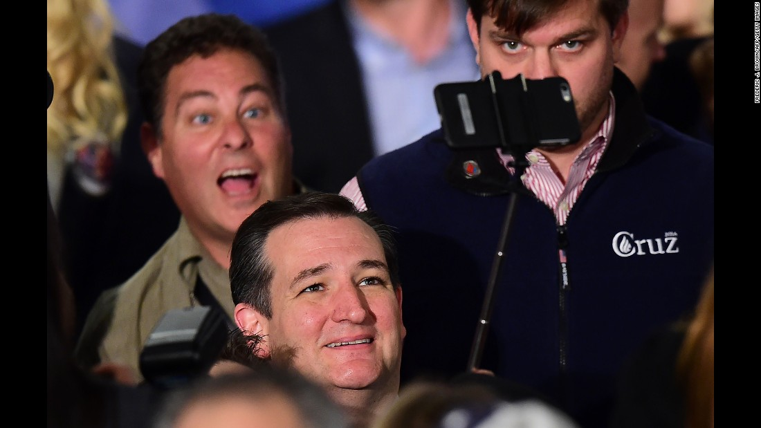 U.S. Sen. Ted Cruz, a Republican presidential candidate, uses a selfie stick during a campaign rally in Irvine, California, on Monday, April 11.