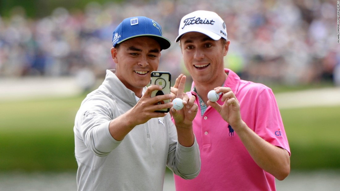 Pro golfers Rickie Fowler, left, and Justin Thomas take a photo together after they both made hole-in-ones at the Masters Par 3 Contest on Wednesday, April 6.