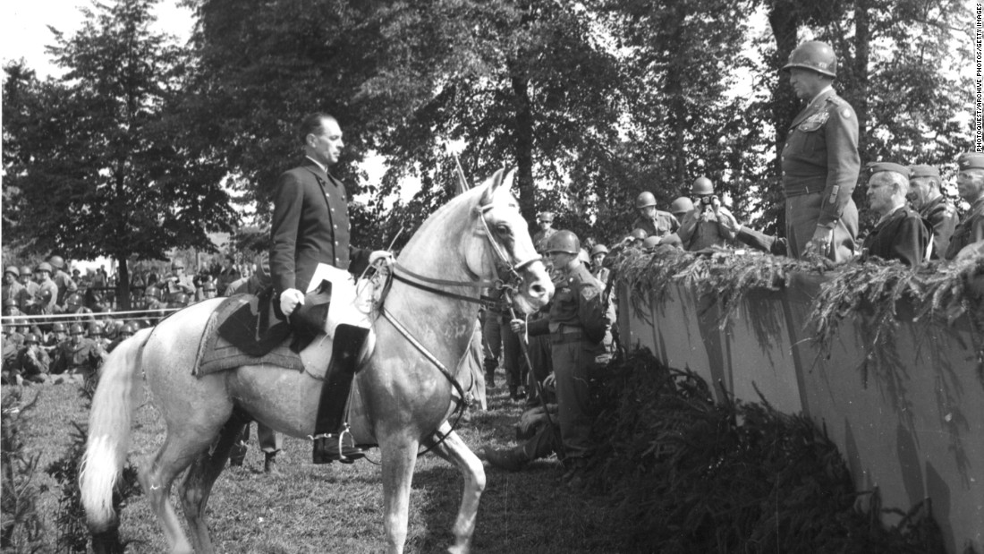 Austrian Colonel Alois Podhajsky, director of the Spanish Riding School from which many of the horses were captured and taken to Hostau, performs for General Patton.