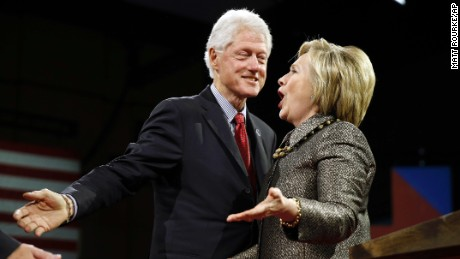 Democratic presidential candidate Hillary Clinton stands with former President Bill Clinton at her presidential primary election night rally on Tuesday, April 26 in Philadelphia.